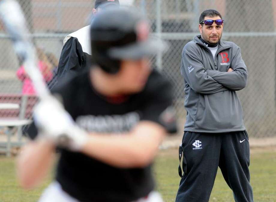 Branford baseball coach Ed Bethke, right, watches during a recent scrimmage. Mara Lavitt/New Haven Register