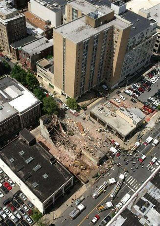 This photo provided by Russell Krause shows  the scene of a building collapse on the edge of downtown Philadelphia on Wednesday June 5, 2013. The four-story building being demolished collapsed, injuring 12 people and trapping two others, the fire commissioner said. Rescue crews were trying to extricate the two people who were trapped, city Fire Commissioner Lloyd Ayers said. The dozen people who were injured were taken to hospitals with minor injuries, he said.(AP Photo/Russell Krause) Photo: AP / Russell Krause