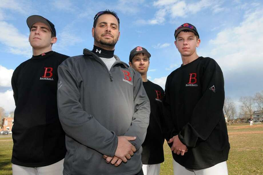 Branford baseball coach Ed Bethke (second from left) is flanked by captains, from left to right: Brad Doyle, Ed Bethke, Marc Canzanella, and Rob Petrillo. Branford will be featured in one of Henry Chisholm's top 10 games to watch this season against Foran later this month. Mara Lavitt/New Haven Register