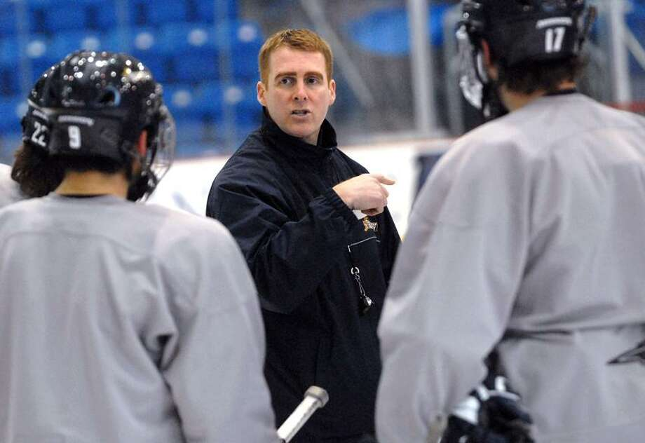 Head coach Rand Pecknold, center, has guided Quinnipiac to the No. 1 ranking in the nation and the NCAA Frozen Four for the first time.
