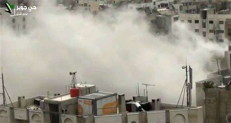 In this Tuesday, April 2, 2013 image taken from video obtained from Shaam News Network, which has been authenticated based on its contents and other AP reporting, shows smoke from heavy shelling in the Jobar neighborhood in north Damascus, Syria. Syrian government warplanes and artillery pounded Damascus and its suburbs Tuesday, as rebels in the northern city of Aleppo launched an operation that aims to free hundreds of political detainees from the city's central prison, activists said. (AP Photo/Shaam News Network) Photo: AP / Shaam News Network