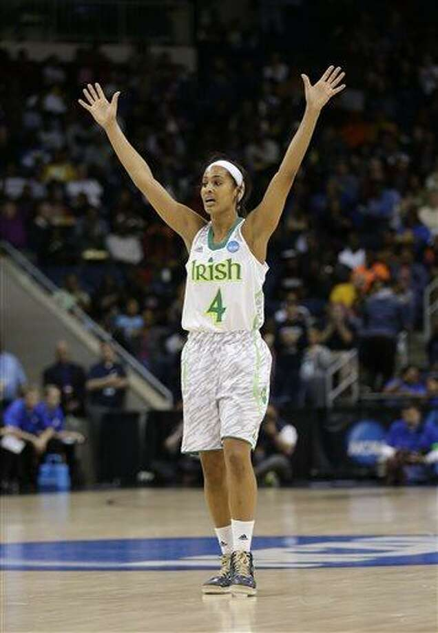 Notre Dame guard Skylar Diggins celebrates a teammate's 3-point basket during the second half of the regional final of the NCAA women's college basketball tournament Tuesday, April 2, 2013, in Norfolk, Va. Notre Dame won 87-76. (AP Photo/Steve Helber) Photo: AP / AP