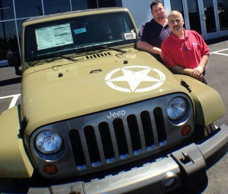 JOHN HAEGER @ONEIDAPHOTO ON TWITTER/ONEIDA DAILY DISPATCH General Sales Manager Scott Mitton and Sales rep Paul Perry pose outside of Summit Chrysler Dodge Jeep RAM on Tuesday, June 4, 2013 Oneida.