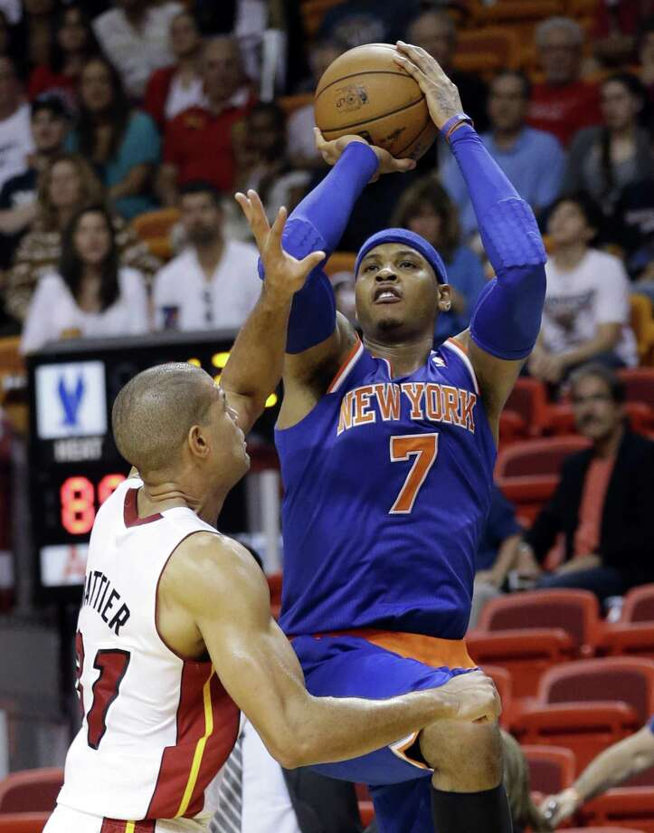 New York Knicks forward Carmelo Anthony (7) takes a shot against Miami Heat forward Shane Battier during the second half of an NBA basketball game, Tuesday, April 2, 2013 in Miami. Anthony tied his career high with 50 points in the Knicks' 102-90 win. (AP Photo/Wilfredo Lee) Photo: ASSOCIATED PRESS / AP2013