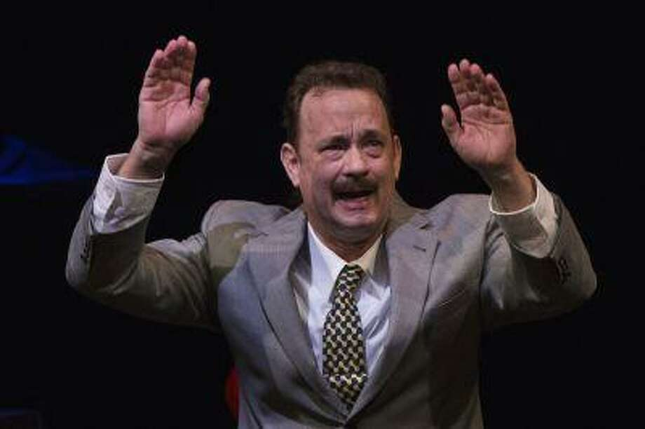 Actor Tom Hanks gestures to the audience after his performance in the premiere of the play Lucky Guy in New York, April 1, 2013. REUTERS/Lucas Jackson (UNITED STATES - Tags: ENTERTAINMENT) Photo: REUTERS / X90066