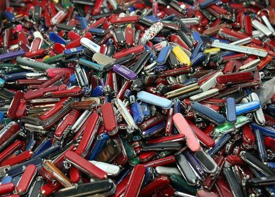 This Sept. 26, 2006 file photo shows knives of all sizes and types are piled in a box at the State of Georgia Surplus Property Division store in Tucker, Ga., and are just a few of the hundreds of items discarded at the security checkpoints of Hartsfield-Jackson Atlanta International Airport that will be for sale at the store. John Pistole, the head of the Transportation Security Administration (TSA) says he's dropping a proposal that would have let airline passengers carry small knives, souvenir bats, golf clubs and other sports equipment onto planes. The proposal had drawn fierce opposition from lawmakers, airlines and others who said it would place passengers and crews at risk. (AP Photo/Gene Blythe, File) Photo: AP / AP