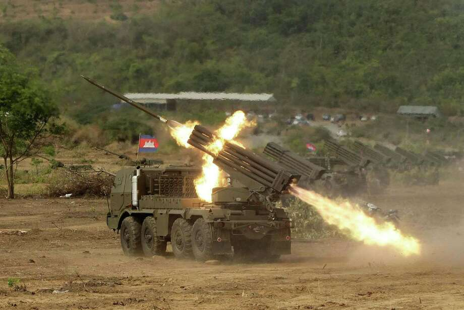 Cambodian army multiple rocket launchers are test fired at Phnom Sruoch complex of Cambodian army base, in Kampong Speu province, some 65 kilometers (40 miles) southwest of Phnom Penh, Cambodia, Tuesday, April 2, 2013. About 107 rounds of Russian-made BM-21 rockets were fired, according to the army. (AP photo/Heng Sinith) Photo: ASSOCIATED PRESS / AP2013
