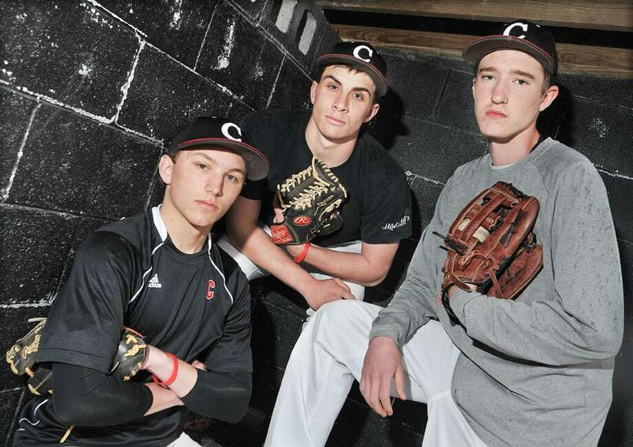 Catherine Avalone/The Middletown Press Seniors and tri-captains of Cromwell baseball team, left to right, Christian Budzik, Alex Ramirez and Doug Davenport. / TheMiddletownPress
