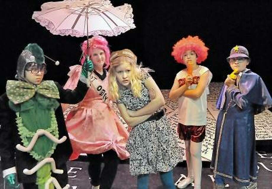 Catherine Avalone/The Middletown Press Oddfellows Playhouse will present Alice Threw the Looking Glass, a comedy by John Walch today through Saturday at 7:30 p.m. Pictured from left to right, Kyle Dougherty as Sesquipedalian, Melissa Hass as Not Only, Atlee Myers as Alice, Kobi Masselli as Run on Red, JJ Chapman, Jr. as Border during dress rehearsal on Monday. / TheMiddletownPress