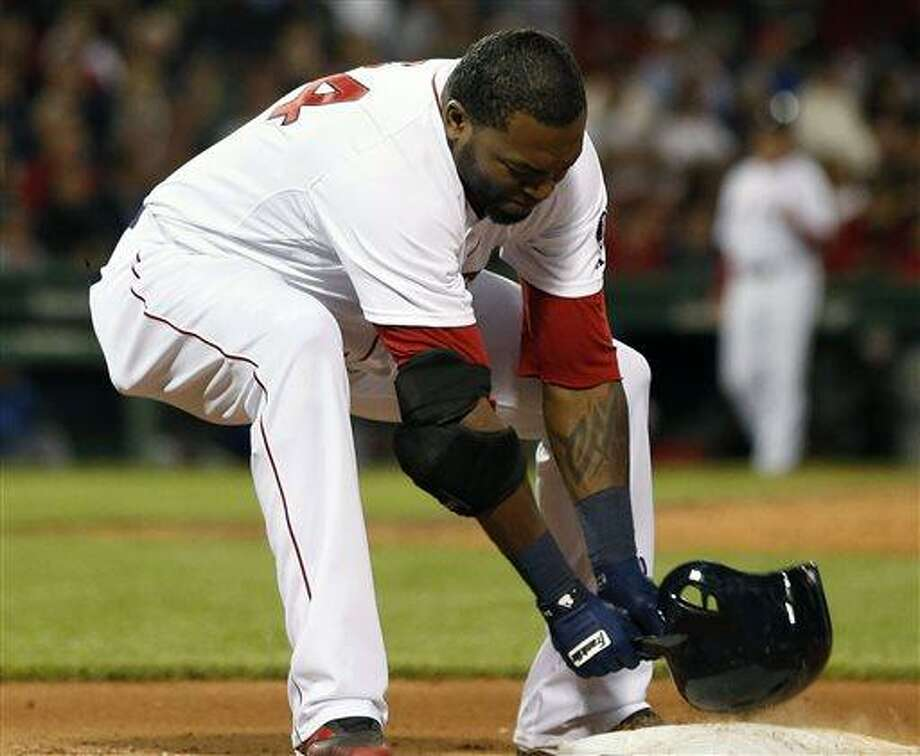 Boston Red Sox's David Ortiz slams his helmet on first base after grounding out in the eighth inning of a baseball game against the Texas Rangers in Boston, Wednesday, June 5, 2013. The Rangers won 3-2. (AP Photo/Michael Dwyer) Photo: AP / AP