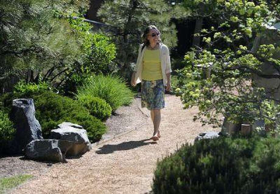 Kriste Brushaber takes a barefoot walk through the Denver Botanic Gardens, making sure to walk dirt paths and the reflexology path. (Kathryn Scott Osler/The Denver Post) Photo: DP / Copyright - 2013 The Denver Post, MediaNews Group.