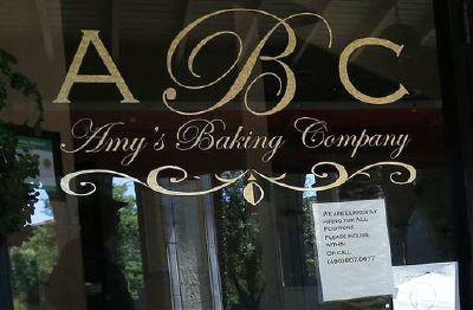 "This Monday, June 3, 2013 photo shows Amy's Baking Company in Scottsdale, Ariz. The restaurant is now hiring staff again. The restaurant temporarily closed after their ""Kitchen Nightmares"" episode aired. The episode of ""Kitchen Nightmares"" drew more than a million viewers on YouTube, and restaurateur Amy Bouzaglo's vitriolic rants became popular fodder on Twitter and Facebook. Bouzaglo announced she is shopping around her own reality TV show. (AP Photo/Ross D. Franklin) Photo: AP / AP"