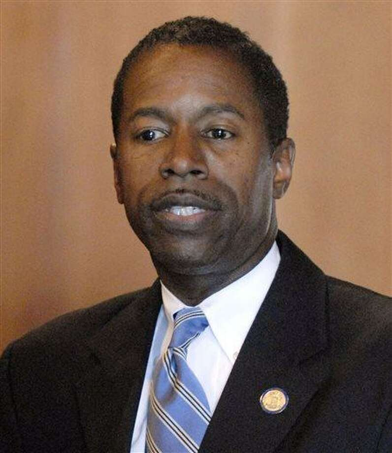 """FILE - In this Dec. 8, 2008 file photo, New York state Sen. Malcolm Smith, D-Queens, speaks with reporters at the Capitol in Albany, N.Y. The FBI says Smith and New York City Councilman Dan Halloran were arrested early Tuesday, April 2, 2013 in an alleged plot to rig the New York City mayor's race. U.S. Attorney Preet Bharara said in a statement that Smith """"tried to bribe his way"""" into a shot at the New York City mayoral race and Halloran found party chairmen who were open to receiving bribes.  (AP Photo/Tim Roske, File) Photo: ASSOCIATED PRESS / AP2008"""