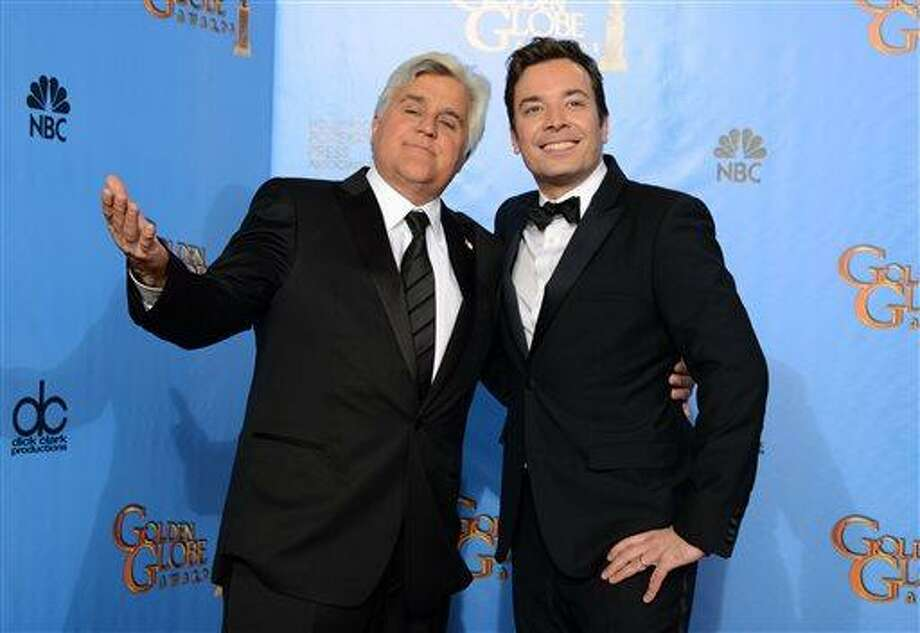 """This Jan. 13, 2013 file photo shows Jay Leno, host of """"The Tonight Show with Jay Leno,"""" left, and Jimmy Fallon, host of """"Late Night with Jimmy Fallon"""" backstage at the 70th Annual Golden Globe Awards in Beverly Hills, Calif. Leno and Jimmy Fallon poked fun at the late-night rumors swirling around them in a music video that aired between their back-to-back NBC shows on Monday, April 1. In a spoof of the romantic ballad """"Tonight"""" from """"West Side Story,"""" Leno, who was backstage at the """"Tonight"""" show on the West Coast, and Fallon, in his """"Late Night"""" office in Manhattan, serenaded each other by cellphone. (Photo by Jordan Strauss/Invision/AP, file) Photo: Jordan Strauss/Invision/AP / Invision"""