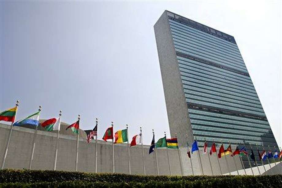 """FILE - In this Sept. 13, 2005 file photo, the flags of member nations fly outside the General Assembly building at the United Nations headquarters in New York. The U.N. General Assembly overwhelmingly approved the first U.N. treaty regulating the multibillion-dollar international arms trade Tuesday, April 2, 2013, a goal sought for over a decade to try to keep illicit weapons out of the hands of terrorists, insurgent fighters and organized crime. The resolution adopting the landmark treaty was approved by a vote of 154 to 3 with 23 abstentions. Iran, North Korea and Syria voted """"no"""" on Tuesday's resolution. (AP Photo/Adam Rountree, File) Photo: AP / AP"""