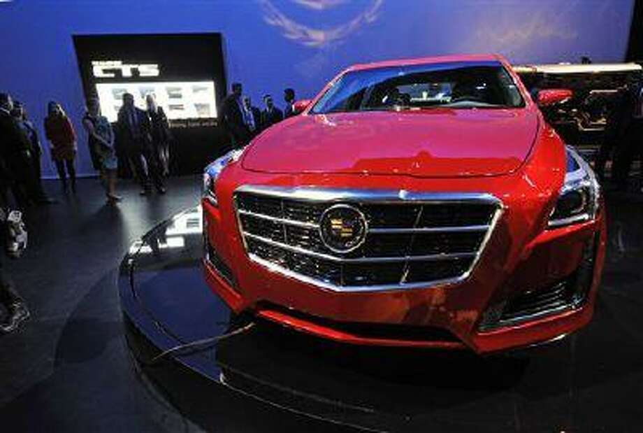 The new 2014 Cadillac CTS is introduced, Tuesday, March 26, 2013 in New York. (AP Photo/Louis Lanzano) Photo: ASSOCIATED PRESS / AP2013