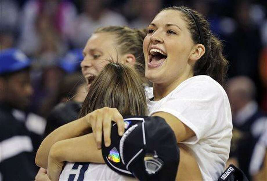 Connecticut forward Breanna Stewart smiles as she embraces teammate Stefanie Dolson after beating Kentucky in the women's NCAA regional final basketball game in Bridgeport, Conn., Monday, April 1, 2013. Connecticut won 83-53 and advances to the Final Four. (AP Photo/Charles Krupa) Photo: ASSOCIATED PRESS / AP2013