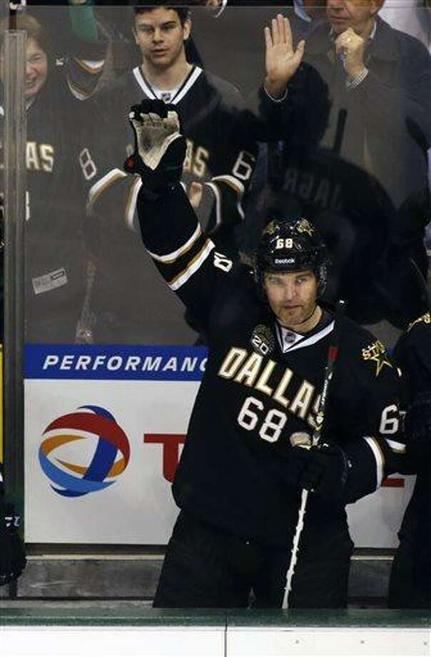 Dallas Stars forward forward Jaromir Jagr (68) waves to the fans as he received a standing ovation during the third period of an NHL hockey game against the Minnesota Wild Friday, March 29, 2013, in Dallas, Texas. Jagr got his 1000th assist during the game. (AP Photo/Sharon Ellman) Photo: ASSOCIATED PRESS / AP2013