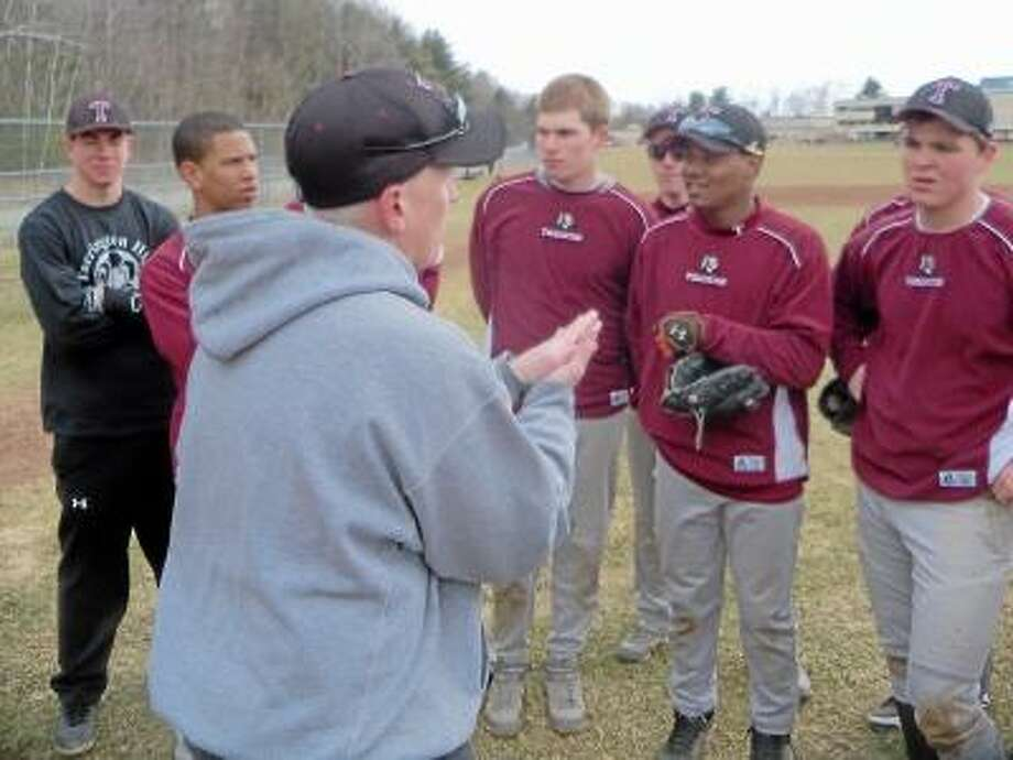 Torrington High School head baseball coach Pat Richardson talks with his varsity team during practice on Tuesday. Photo by Peter Wallace/Register Citizen