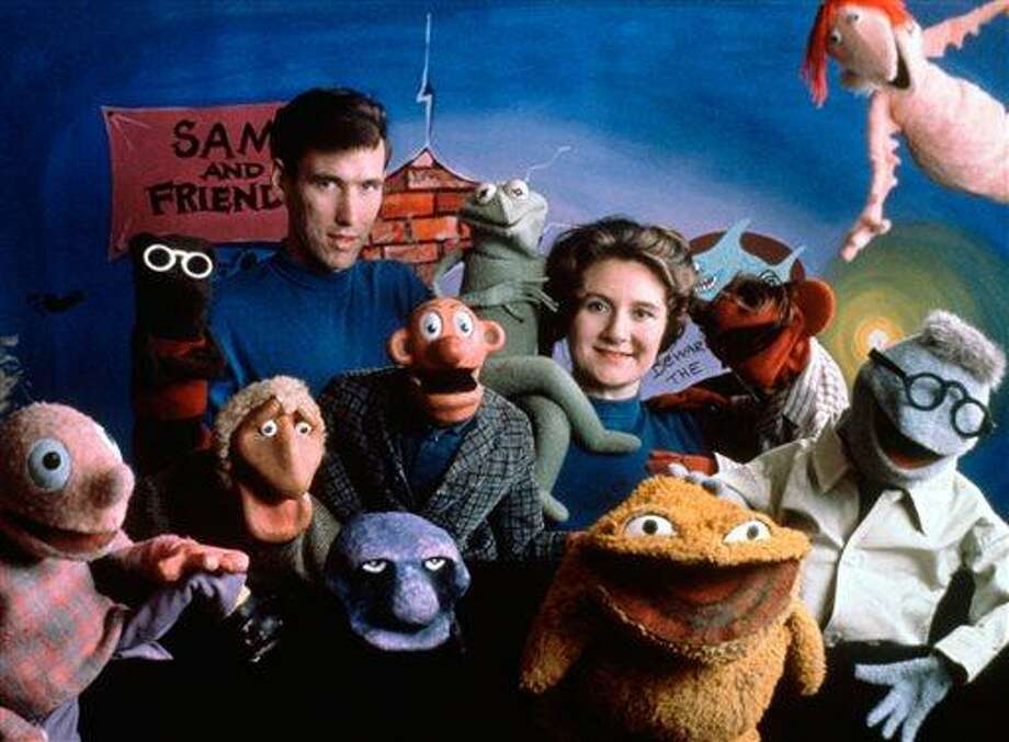This 1960 handout photo provided by The Jim Henson Company shows Jane Henson, right, with Jim Henson and the cast of Sam and Friends, in Washington. Jane Henson died in her Connecticut home on April 2, 2013 after a long battle with cancer.  (AP Photo/The Jim Henson Company, Del Ankers) Photo: AP / The Jim Henson Company