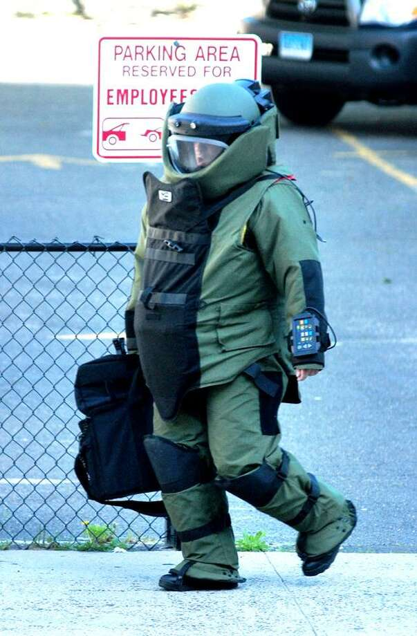 Officer Joe Tempesta of the New Haven/Yale Bomb Squad responds to a report of a possible explosive device in front of 200 Orange St. in New Haven on 6/4/2013.Photo by Arnold Gold/New Haven Register  AG0501B