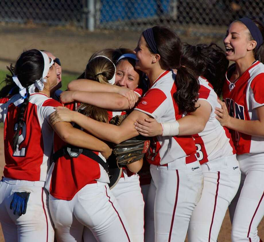"Foran pitcher Jessica Harkness, center, celebrates with her teammates after Foran beat Maloney 5-4 for the Class L state softball semifinal Tuesday.  Photo-Peter Casolino/Register  <a href=""mailto:pcasolino@newhavenregister.com"">pcasolino@newhavenregister.com</a>"