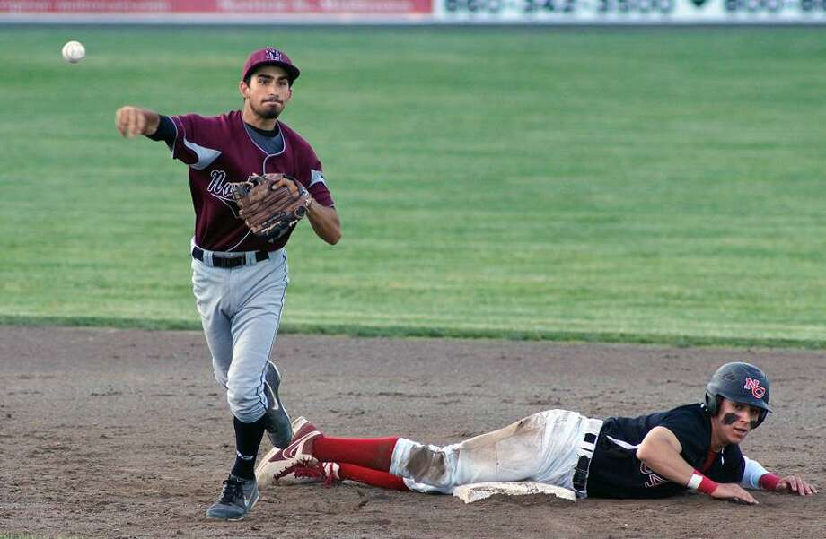 """North Haven's John DeCusati turns the double play as New Canaan's Alexander LaPolice slides into second base during the second inning of the Class L state semifinals.  Photo-Peter Casolino/Register  <a href=""""mailto:pcasolino@newhavenregister.com"""">pcasolino@newhavenregister.com</a>"""