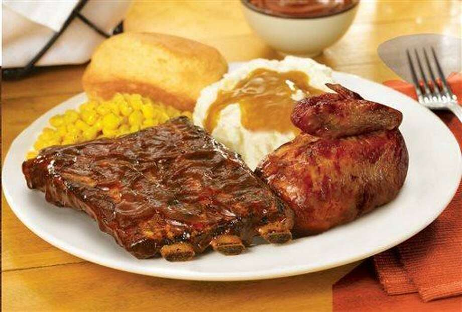 "This undated product image provided by Boston Market shows the restaurant's new St. Louis-style ribs offering. The Golden, Colo.-based chain hopes the ribs, its biggest new food launch in six years, will help bring new customers into its restaurants. It's kicking off the launch with a tax-themed ad campaign starting April 1 with the slogan, ""The Big Rib-ate."" (AP Photo/Boston Market) Photo: AP / Boston Market"