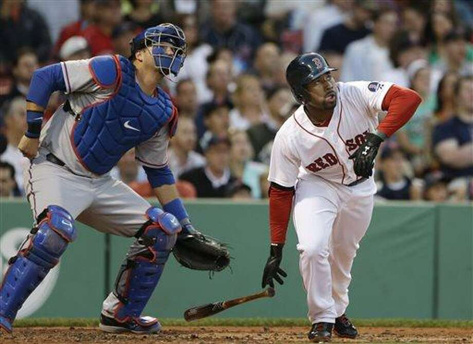 Boston Red Sox's Jackie Bradley Jr. follows through as Texas Rangers catcher A.J. Pierzynski watches his two-run homer during the second inning of a baseball game at Fenway Park in Boston, Tuesday, June 4, 2013. (AP Photo/Elise Amendola) Photo: AP / AP