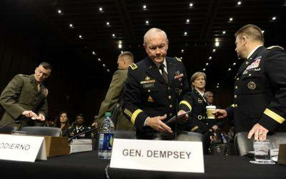 Joint Chiefs Chairman Gen. Martin Dempsey arrives on Capitol Hill in Washington, Tuesday, June 4, 2013, to to testify before the Senate Armed Services Committee hearing on pending legislation regarding sexual assaults in the military. Determined to stop sexual assault in the military, Congress is spelling out for the services how far lawmakers are willing to go in changing the decades-old military justice system. (AP Photo/Susan Walsh) Photo: AP / AP