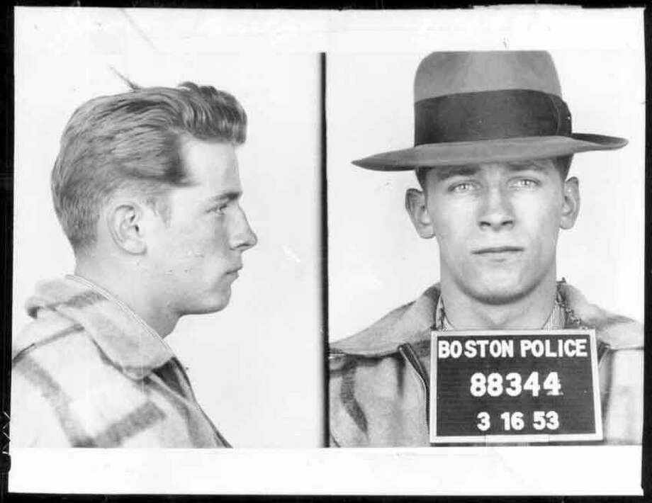 "This 1953 Boston police booking photo shows James ""Whitey"" Bulger after an arrest.  Bulger and his girlfriend Catherine Greig, were apprehended Thursday, June 23, 2001, in Santa Monica, Calif., after 16 years on the run.  (AP Photo/Boston Police via The Boston Globe)  WCVB-TV,  <a href=""http://thebostonchannel.com"">thebostonchannel.com</a> OUT Photo: AP / 1995 AP"