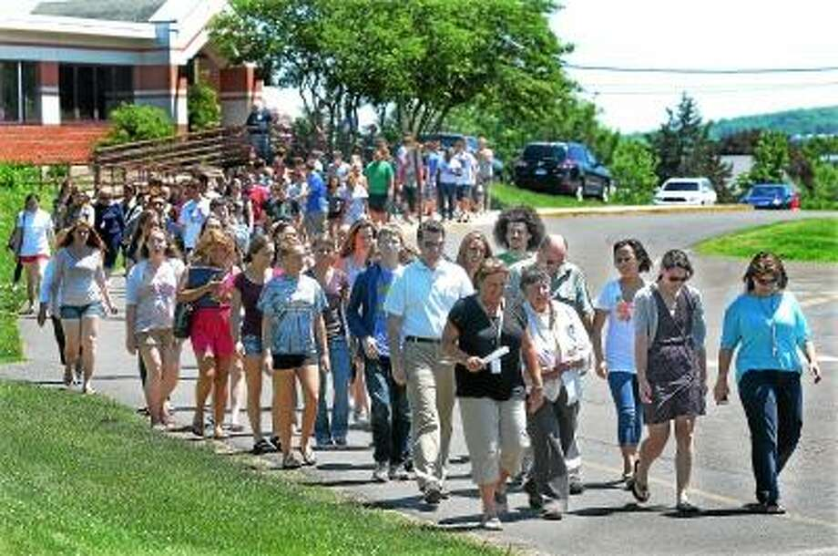 Catherine Avalone/The Middletown Press Students, staff and administration from Portland High School exit Valley View Elementary School during an evacuation drill Tuesday afternoon. Students from both the junior and senior high school made the one tenth of a mile trek from the junior-senior high schools to the elementary school on High Street. / TheMiddletownPress