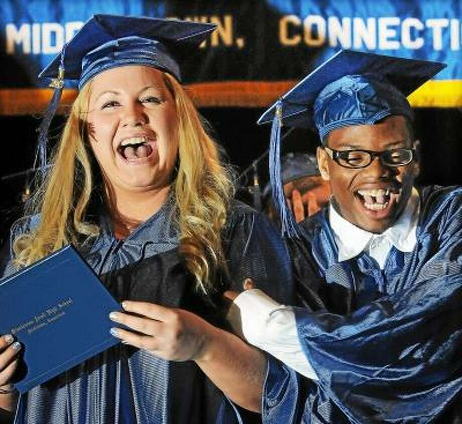 Catherine Avalone/The Middletown Press Middletown residents Vivian Brow and Royal Cade celebrates after receiving their diplomas at the Middletown Adult Education 68th Commencement Tuesday evening at Middletown High School auditorium. / TheMiddletownPress