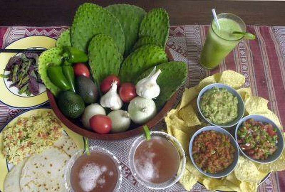 Shown are various foods and beverages prepared with cactus and a variety of vegetables. Nopales and eggs, bottom left; beef and cactus stir fry, top left; cactus juice cocktails, bottom center; sweet nopalitos smoothie, top right; nopales salsas and cactus avocado dip, bottom right. Photo: ASSOCIATED PRESS / AP2001