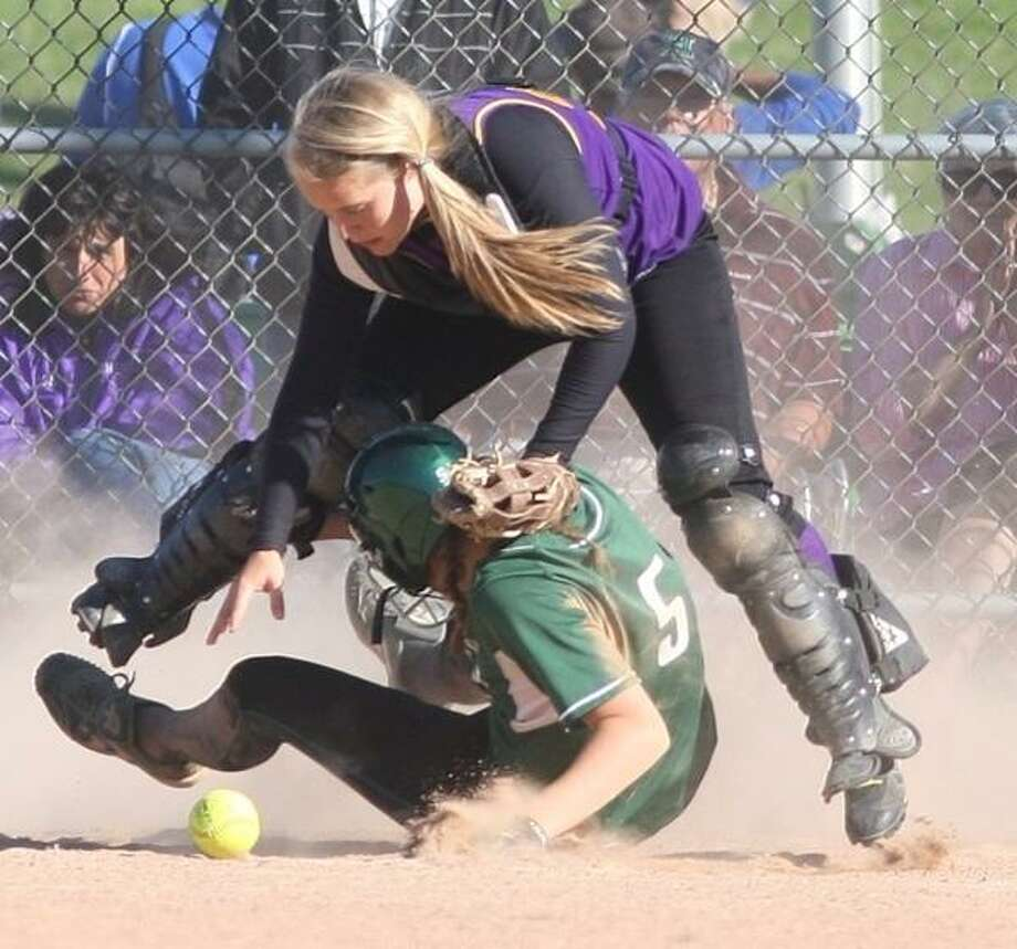 JOHN HAEGER @ONEIDAPHOTO ON TWITTER/ONEIDA DAILY DISPATCH Hamilton's Cydnee Wendt (5) scores as Heuvelton's Hannah Thornhill  (27) bobbles the ball in the fifth inning of their NYSPHSAA Class D quarterfinal on Tuesday, June 4, 2013 in Cicero. Hamilton won 14-0 to advance to the semifinal.