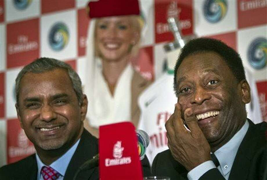 Brazil´s soccer legend Pele, right, and Nabil Sultan, vice president of Emirates Airline, smile during a press conference on Tuesday, June 4, 2013 in New York.  Pele, 72, the honorary president of the New York Cosmos soccer club, appeared for the announcement that the revived team signed a sponsorship contract with Emirates Airline, as the team prepares to play in the North American Soccer League this summer.  (AP Photo/Bebeto Matthews) Photo: AP / AP