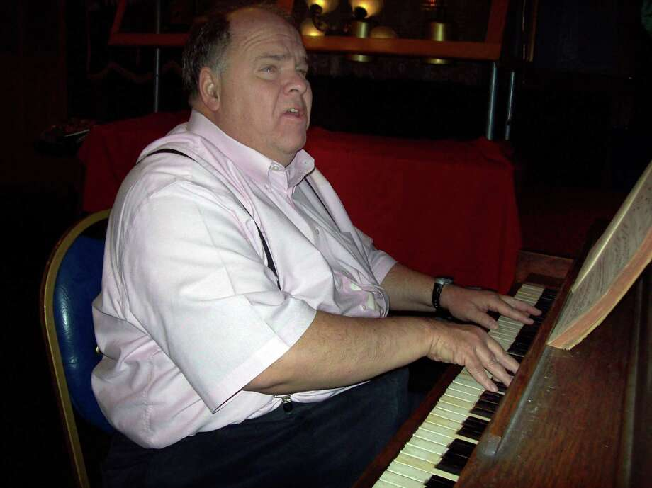 Photo Special to the Dispatch by MIKE JAQUAYS Sukosh Fearon plays piano and sings after the Lions Club zone meeting March 26, 2013 at the Madison House Restaurant in Oneida.
