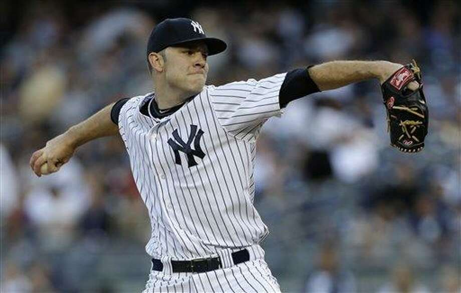 New York Yankees relief pitcher David Phelps delivers in the first inning of a baseball game against the Cleveland Indians at Yankee Stadium in New York, Tuesday, June 4, 2013.  (AP Photo/Kathy Willens) Photo: AP / AP