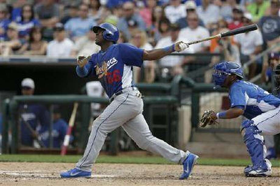 Los Angeles Dodgers' Yasiel Puig hits against the Kansas City Royals during the sixth inning in an exhibition spring training baseball game Wednesday, March 20, 2013, in Surprise, Ariz. (AP Photo/Gregory Bull) Photo: ASSOCIATED PRESS / AP2013
