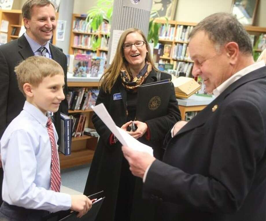 John Haeger @OneidaPhoto on Twitter/Oneida Daily Dispatch North Broad Elementary Student Dylan Price, looks on after presenting congressman Richard Hannah  his own take  the federal budget during his visit on Friday, March 22, 2013.Price  like to see massive cuts in spending.