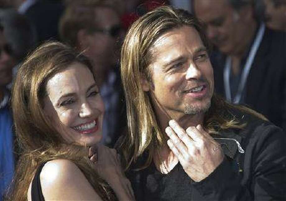 Brad Pitt and Angelina Jolie arrive for the World Premiere of World War Z at a central London cinema June 2, 2013. Photo: Joel Ryan/Invision/AP / Invision