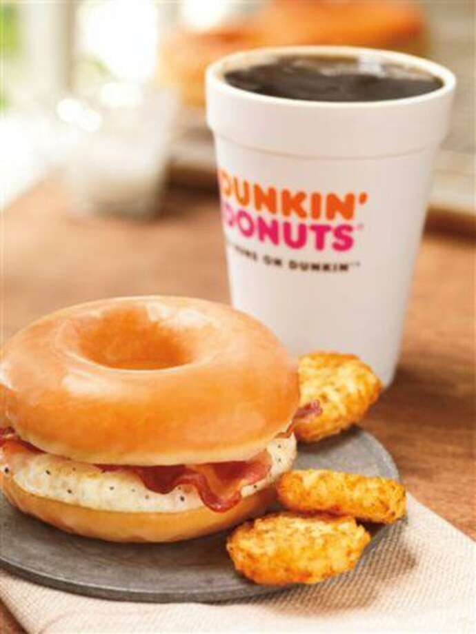 This photo provided by Dunkin' Brands, Inc., shows the company's glazed donut breakfast sandwich. Even as fast-food chains tout their healthy offerings, they're also coming up with fatty new treats to keep customers interested. Case in point: Dunkin' Donuts is adding a doughnut breakfast sandwich to its national menu beginning June 2013. (AP Photo/Dunkin' Brands, Inc., James Scherer) Photo: AP / Dunkin' Brands, Inc.