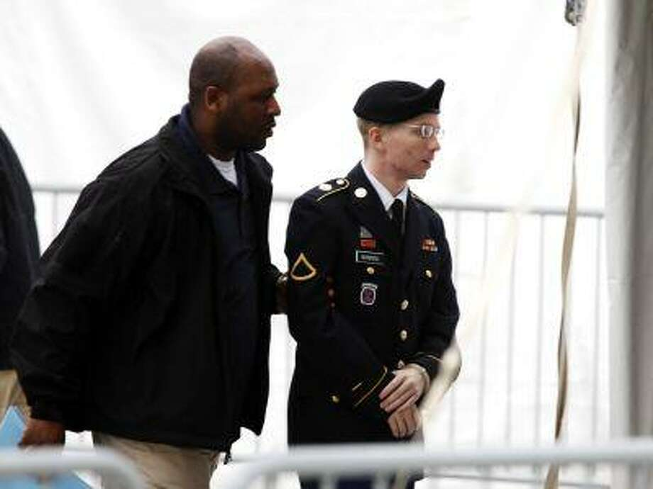 U.S. Army Private First Class Bradley Manning (R) arrives at the courthouse for a motion hearing at Fort Meade in Maryland, May 21, 2013. (Jose Luis Magana/Reuters) Photo: REUTERS / X02232