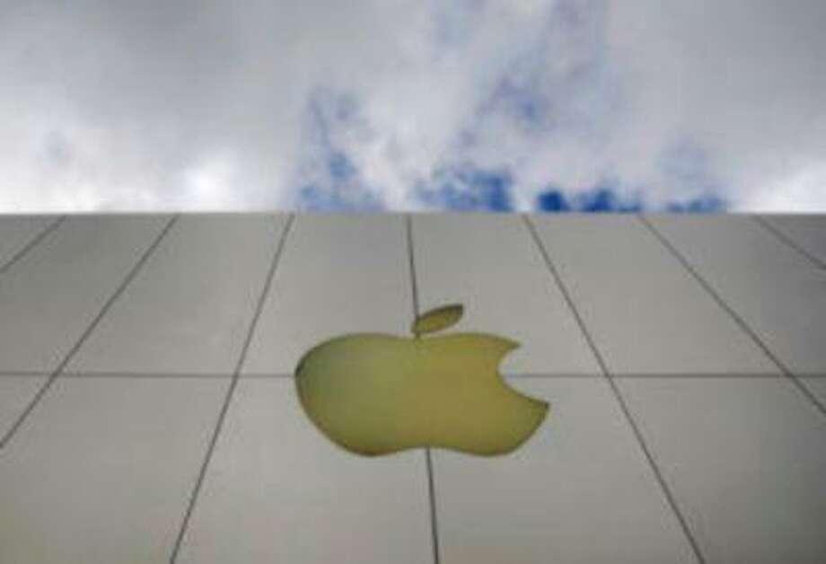 The Apple logo is seen on an Apple store in San Francisco. (AP Photo/Russel A. Daniels, File) Photo: AP / AP net
