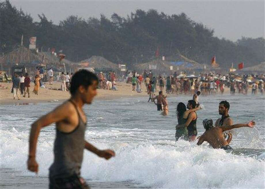 In this March 9, 2013 file photo, tourists play on the Baga Beach in Goa, India, a popular destination among Indian and foreign tourists. The rape and murder of a young woman in New Delhi in December followed by two attacks on foreign female travelers has altered how tourists view India and led to a sharp fall in the numbers of foreign tourists, especially women, a study released Sunday, March 31, 2013 said. AP Photo/ Rajesh Kumar Singh Photo: AP / AP