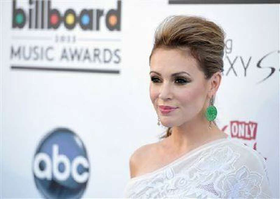 Alyssa Milano arrives at the Billboard Music Awards at the MGM Grand Garden Arena on May 19, 2013 in Las Vegas. (John Shearer/Invision/AP) Photo: John Shearer/Invision/AP / Invision