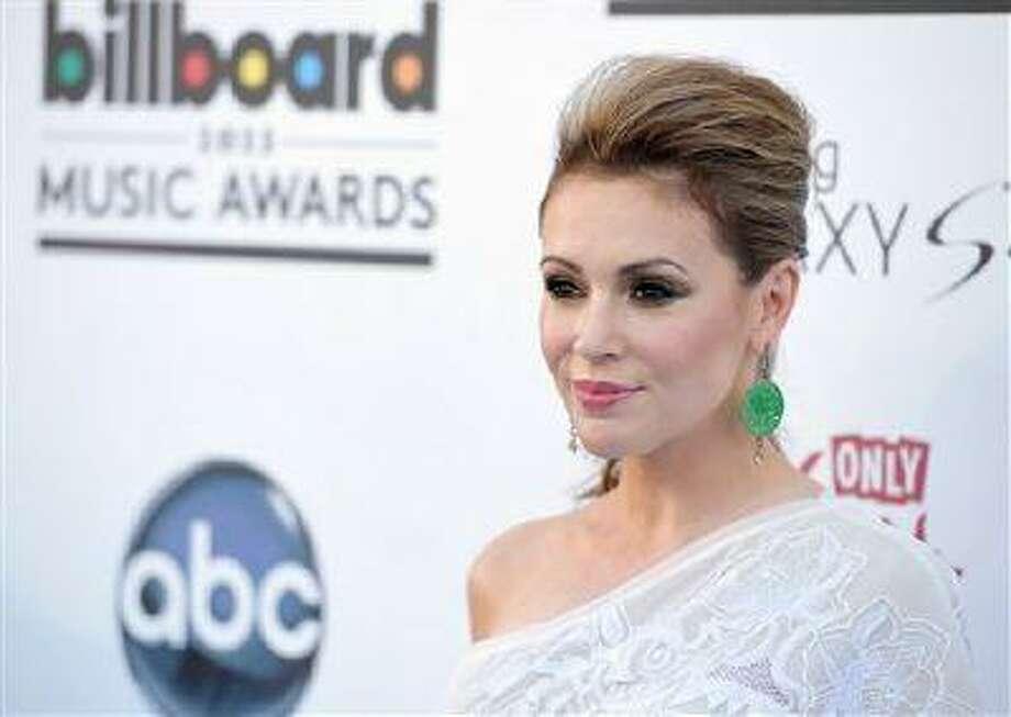 Alyssa Milano arrives at the Billboard Music Awards at the MGM Grand Garden Arena on May 19, 2013 in Las Vegas. (John Shearer/Invision/AP) Photo: John Shearer/Invision/AP / Invision