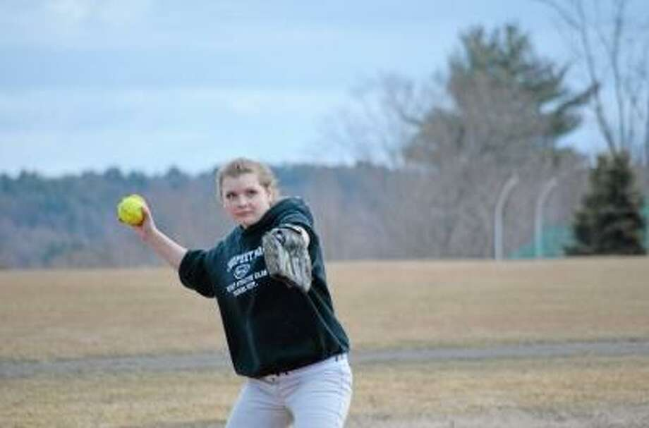 Pete Paguaga/Register Citizen  Tricia Benet, the only returning senior on the softball team, working on her fielding skills...