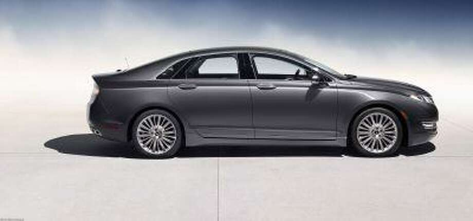 The all-new 2013 Lincoln MKZ is beautiful, elegant in its simplicity. Redesigned for 2013, the all-wheel-drive sedan is a wonderfully uncluttered, deceptively beautiful automobile, a work of flowing lines inside and out. Photo: The Washington Post / The Washington Post