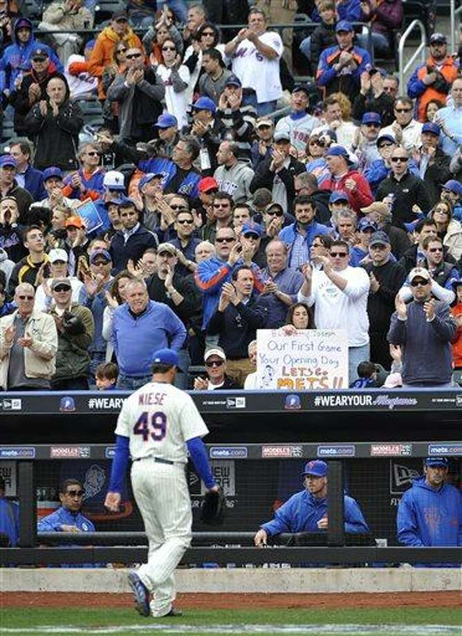 New York Mets fans cheer starting pitcher Jonathon Niese (49) as he walks to the dugout after being taken out of the baseball game against the San Diego Padres in the seventh inning on Opening Day of a baseball game at Citi Field on Monday, April 1, 2013 in New York. The Mets won 11-2. (AP Photo/Kathy Kmonicek) Photo: ASSOCIATED PRESS / AP2013